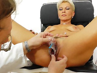 Mature blonde with saggy boobies is having nice sex with that perverted gyno doctor