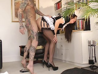 Cute tattooed chick with nice stockings Lara Latex is giving a deep blowjob for brunette dude James