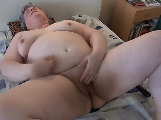 Perverted fat mature Luise is lying on the sofa and stimulating her shaved pussy with toys