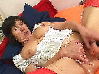 Lilie is laying on her bed while putting her new sex toy in her bearded clam in hopes to get satisfied.