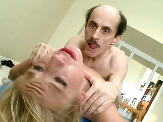 Spicy blonde with pigtail is getting drilled in her shaved puss by an old guy during her workout