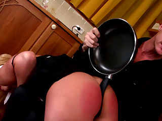 Alluring blonde Zorah White with pretty face being spanked by her master right on the table