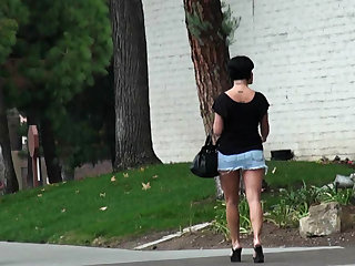 She wears the shortest denim skirt possible in public and we watch her do her business.