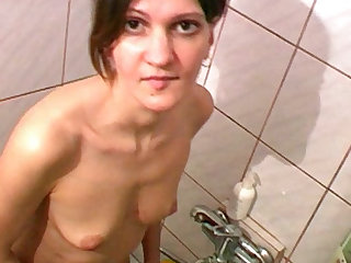 The young and slender chick with small tits takes a piss in the shower and looks so hot.
