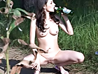 She is beautiful and her breasts are utterly mind blowing as she strips to piss outdoors.