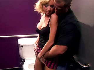 The blonde pornstar with perky tits gets laid while bent over the toilet in the bathroom.