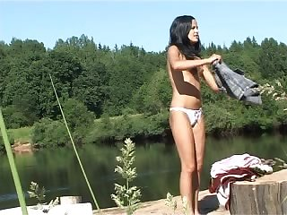 The hidden cam captures a teen skinny dipping in the lake and pissing outdoors.