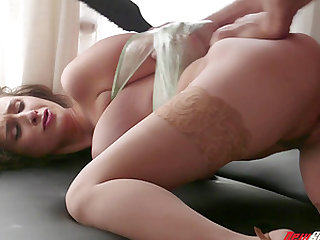 Ashley Adams tied up during an erotic BDSM sex session