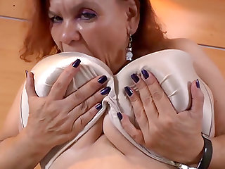 Nice big and round latin granny playing with boobs and masturbating