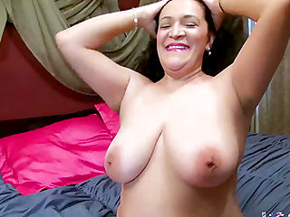 Mature chubby granny lady possessing huge breasts is playing with them seductively