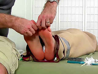 Fit and cute dude Kenny gets his feet tickled by older man