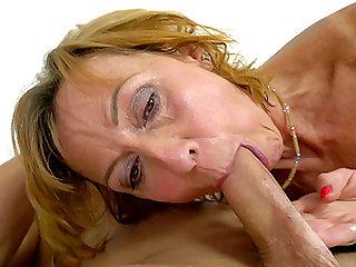 Horny mature woman Lotty Blue enjoys a fellow's prick