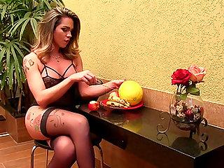Shemale Amanda Fialho fucks a melon