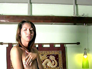 Small tits cute shemale giving dick blowjob while wanking