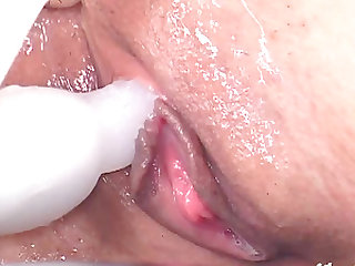 Sloppy Asian cougar with natural tits worshipped by two guys