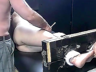 Dark haired dude begging for mercy while tied and tickled
