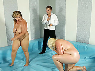 Busty chicks Monika and Mira wrestle for a hunk's erected cock