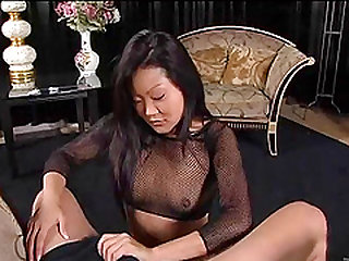 A mature chines giving a blow job to a guy