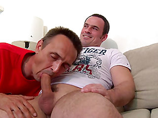 Gay relaxing while his monster cock gets replenished with blowjob