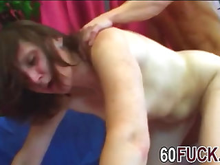 Brunette granny exposing perky nude tits with handsome thick cock lad