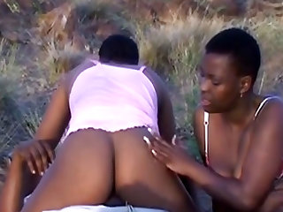 Three African sluts get two stiff cocks outdoors