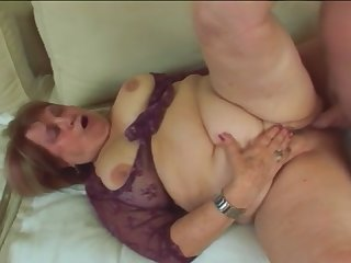 Chubby granny with large boobs rubs her pussy and gets banged hard