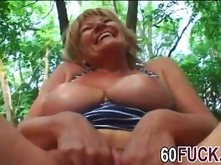 Granny Stally blows cock and gets banged outdoors