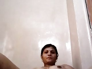 Desi Aunty playing with her tight pussy