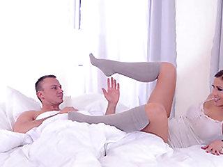Satin Bloom uses her feet to make a man's prick hard