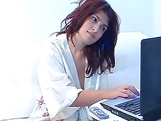 Hot redhead babe with big tits stripteasing and fingering her pussy on web cam