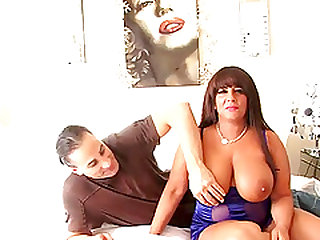 Busty MILF bends over for a handsome stud's big penis