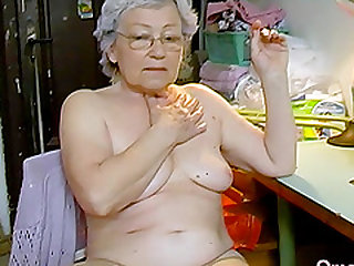 Hot grandma is playing naked with her hairy pussy and favourite toy