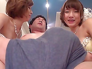 Elegant Japanese chicks attack a hunk for a threesome