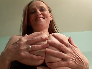 Classy Granny in stockings fingering her pussy seductively