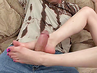 Skinny redhead with a shaved pussy enjoying a hardcore fuck on her sofa