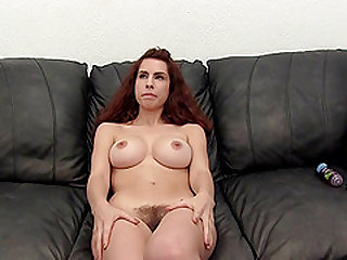 Redhead Sierra loving her pussy getting licked indoors
