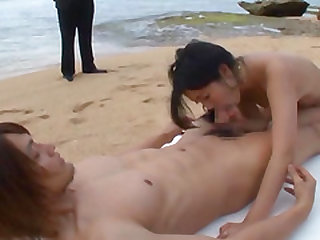 Asian hottie Mizuki Miri places her hairy twat on a cock at the beach