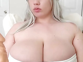 Fat babe show her huge tits and sucks a dildo