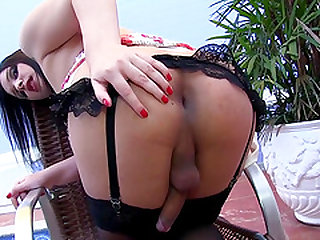 Brunette Shemale Sara Oliveira Strokes Her Hard Cock