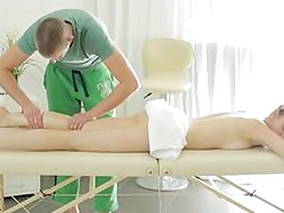 Teen girl fucked in the pussy on the massage table